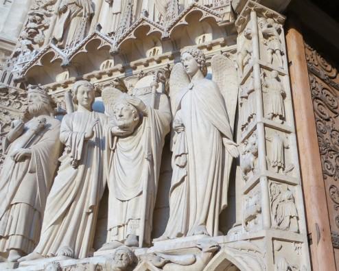 St Denis Holding His Head Notre Dame Paris France