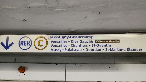 Direction signs to RER C platform in metro station Paris France