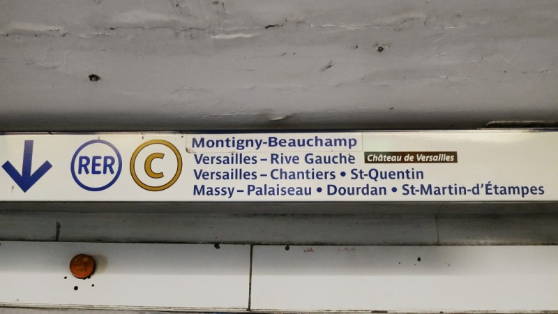 Direction signs to RER C platform in metro station Paris France