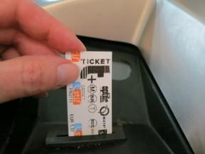 Remove ticket into turnstyle Paris France