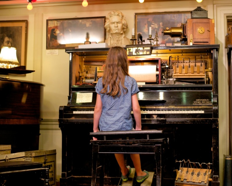 Young Girl Playing a Grandiola Pianola Museum Amsterdam